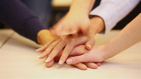 Students stacking hands for support Royalty Free Stock Photo