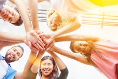 Students stacking their hands together Royalty Free Stock Image