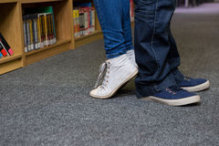 Students standing back-to-back in the library Stock Photos