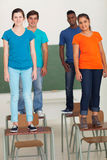 Students standing desks Royalty Free Stock Images