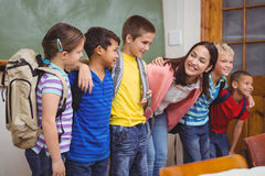 Students standing in front of blackboard Royalty Free Stock Images
