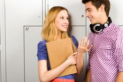 Students standing by lockers Stock Photos