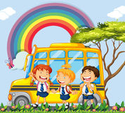 Students standing next to the school bus Royalty Free Stock Photography