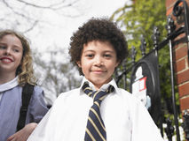 Students Standing By School Gate Stock Photo