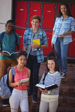 Students standing on staircase Royalty Free Stock Photo