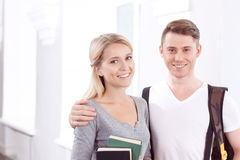 Students standing in university hall Stock Images