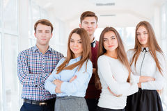 Students standing in university hall. Group of a students standing in university hall and looking at camera Stock Image