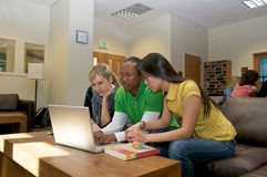 Students in Student lounge. Diverse ethnic Students on university campus. A photo of Asian, African American and Caucasian students Stock Image