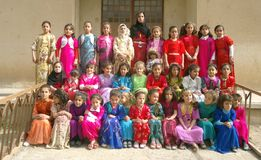 Students. Student of third class in a school in kurdistan, they dressed coulored traditional kurdish clothes to take part of 8th march. International Women's Day royalty free stock photography