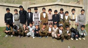 Students. Student of third and fifth class in a school in kurdistan, they wearing traditional kurdish clothes to take part of 8th march. International Women's stock image