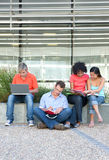 Students studying. Portrait of students studying outside Stock Photo