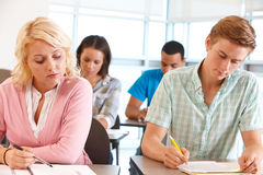 Students studying in classroom Royalty Free Stock Photos