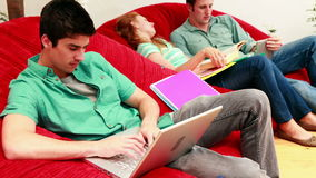 Students studying in the common room on beanbags stock footage