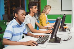 Students studying in computer classroom. At school Stock Image