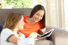 Students studying on a couch at home Stock Photos