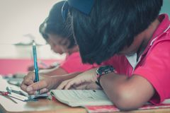 Students are studying in the elementary school classroom. Students are studying in the elementary school classroom of Thailand Stock Photos