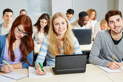 Students studying with computer. Students studying with laptop computer in class in university stock images