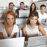 Students studying with laptops in class room Royalty Free Stock Photography