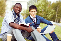 Students Studying on Lawn Royalty Free Stock Photo