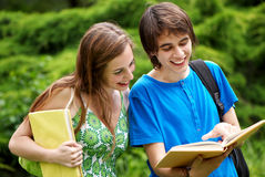 students studying outdoors Stock Photo
