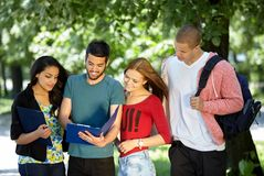 Students studying outside Royalty Free Stock Photos