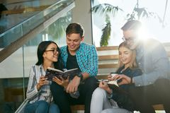 Students Studying, Reading Educational Information In College. Students Studying, Reading Educational Book In College. Young People Discussing Notes On Stairs Stock Photos