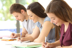 Students studying taking notes in a classroom Stock Photos
