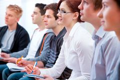 Students studying together in classroom Stock Photo