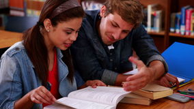 Students studying together in the library stock footage