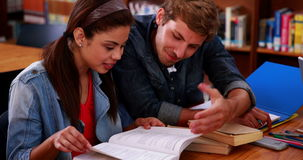 Students studying together in the library stock video