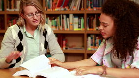 Students studying together in the library stock video footage