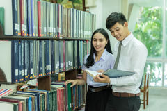 Students studying together in the library stock photo