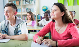 Students studying together. Young attracrive students studying together in the classroom Royalty Free Stock Images