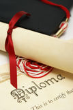 Students Success. A diploma and grad hat represent a high achieving student Royalty Free Stock Images