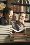 Students Surrounded by Books - Vertical Stock Photos