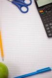 Students table with school supplies Royalty Free Stock Image