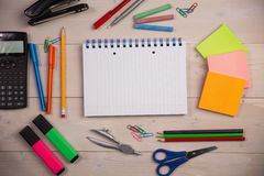 Students table with school supplies Stock Photos