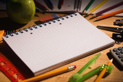 Students table with school supplies Royalty Free Stock Photo