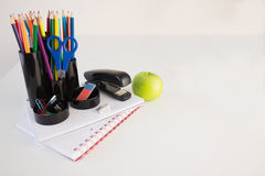 Students table with school supplies Stock Photo