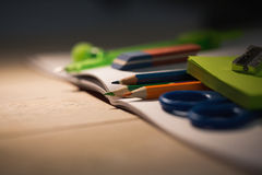 Students table with school supplies Stock Images