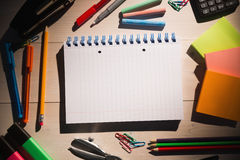 Students table with school supplies Royalty Free Stock Photos