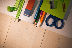 Students table with school supplies Royalty Free Stock Images