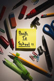 Students table with school supplies Stock Photography