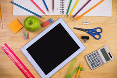 Students table with school supplies Stock Image