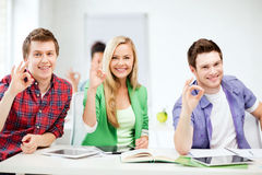 Students with tablet pcs showing ok sign Royalty Free Stock Photography