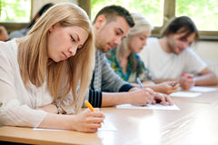 Students take the test. Group of students takes the test in class Stock Image