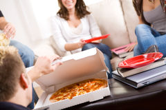 Students: Taking A Break From Studying For Pizza Stock Image