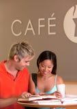 Students taking coffee break. Portrait of students taking coffee break Royalty Free Stock Images