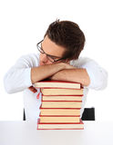 Students taking a nap on pile of books Royalty Free Stock Photos