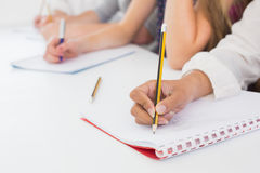 Students taking notes in class Stock Images